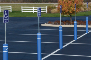 FlexPost® FlexBollard-XL™ Units with Sign Posts - Installed in a Parking Lot with ADA Signage